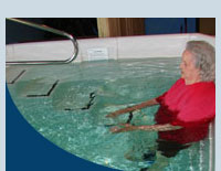Patients exercise in the aquatic therapy pool to heal injuries.